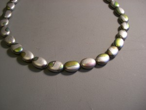 "Simple necklace of grey ""pigeon"" beads"