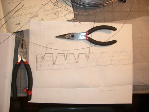 Some early bends of a wire choker/collar in progress