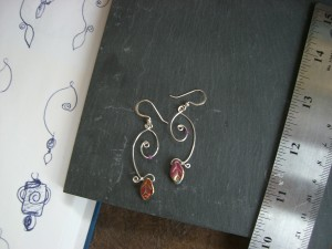 Earrings with wire spirals and glass dangles