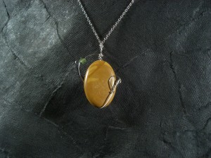 reverse side of Lonely Orbit stone and wire pendant