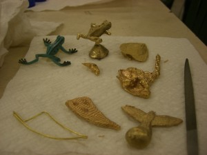 A frog, leaf, blob, bird and tooth shape cast in various methods.